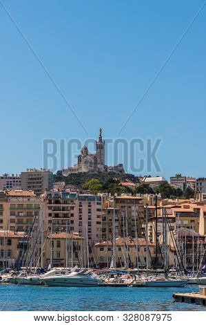 Marseille France. 22 June 2019. A View Of The Old Port Vieux Port And Basilique Notre Dame De La Gar