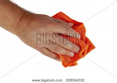A Hand Holds A Rag And Wipes The Dust On A White Background. Isolate Closeup.