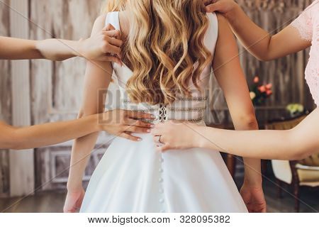 Bride Putting On Her White Wedding Dress. Wedding Celebration Concept. Beautiful Lace Wedding Dress
