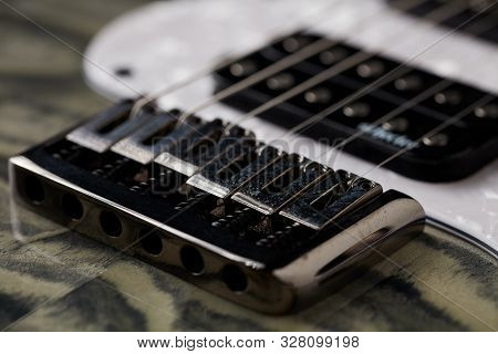 Close Up Of Electric Guitar Bridge. Music Background.
