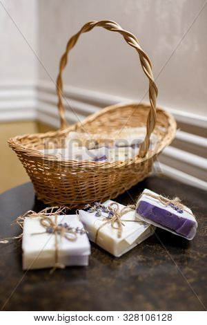 Lavender Soap And Salt In A Wicker Basket. A Gift For Guests.