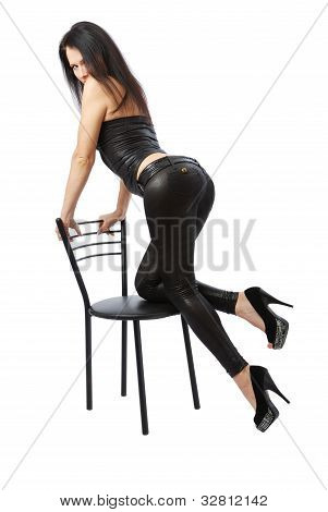 Sexy Woman Leaning On The Chair