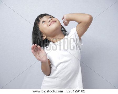 Portrait Of Little Asian Baby Girl Doing Goofy Dance, Fun Happy Expression