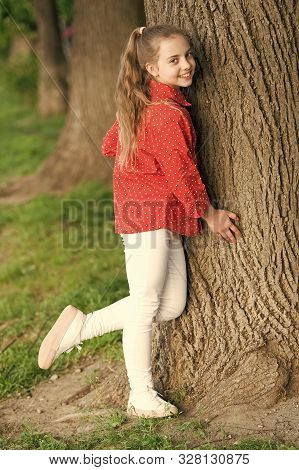 Girl Little Cute Child Enjoy Peace And Tranquility At Tree Trunk. Calm And Peaceful. Life Balance. P