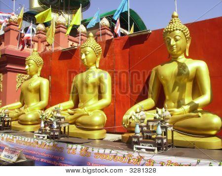 Three Golden Buddha Images.