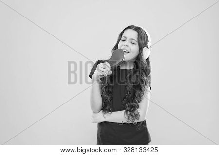 Keep A Song In Your Heart. Adorable Song Singer. Cute Small Child Doing Vocal On Song On Yellow Back