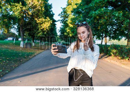Teenage Girl Schoolgirl, Teenager Headphones Taking Pictures Themselves Phone, Happy Smiling Having
