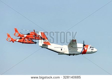 San Francisco, Ca -  Oct 11, 2019: Two Coast Guard Helicopters Flanking The Coast Guard Plane As It
