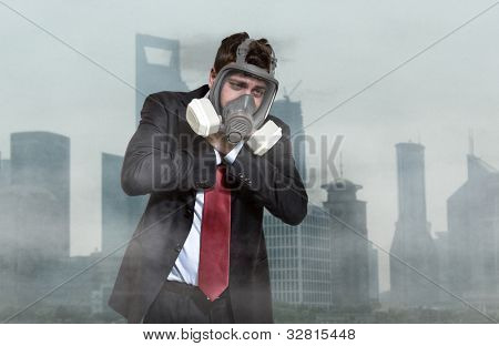 Portrait of a man choking in a polluted city