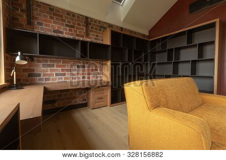 Contemporary Interior Of Light Spacious Living Room With Brown And Black Wooden Furniture And Yellow