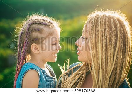 Mother And Child Girl Playing And Hugging. Braiding Hair. Nice Child Girl With Plaits. Hair In Trend
