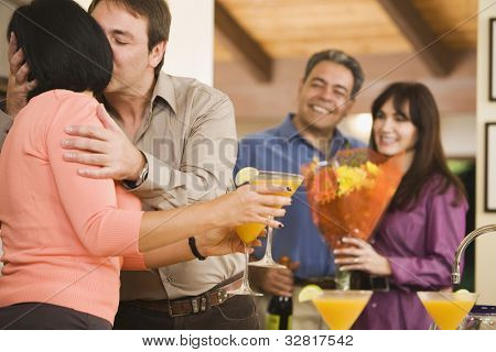Multi-ethnic middle-aged couple kissing