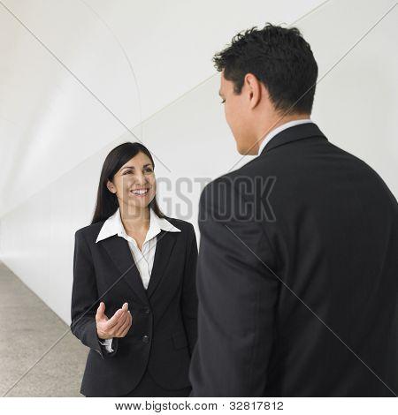 Businesspeople talking in hallway
