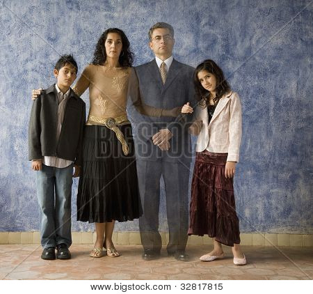 Portrait of Hispanic family with ghosted image of father