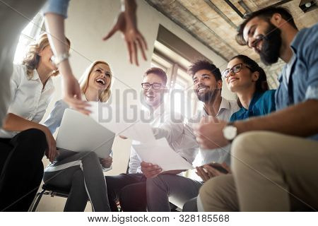 Group Of Business Professionals Having A Meeting. Diverse Group Of Designers Smiling At The Office.