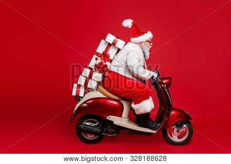Profile Side View Portrait Of Nice Bearded Funny Funky Purposeful Santa Claus Riding Moped Hurry Up