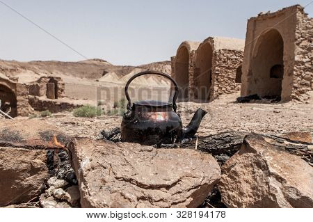 Tea Kettle On Campfire In Iranian Desert Dasht-e Kavir Near Abandoned Village. Version 2.