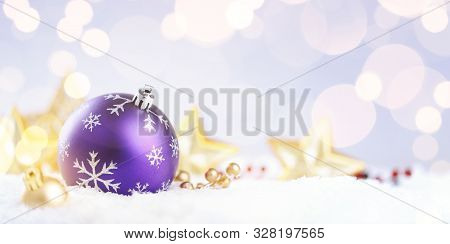 Purple Christmas Ball On A Sparkle Background