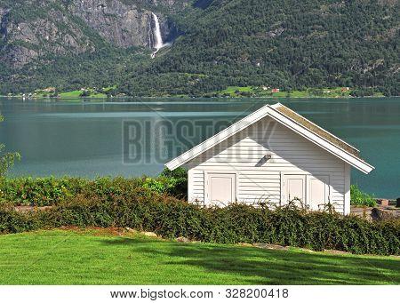 Traditional Scandinavian Wooden House At Lake