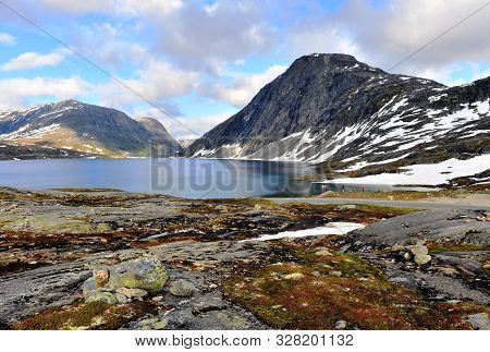 Nordic Landscape With Mountains And Lake Water