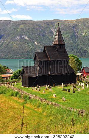 Vertical Shot Of Stave Church In Ornes Village