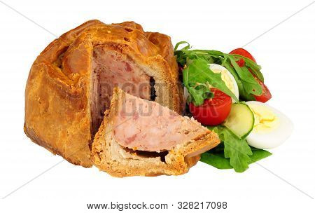 Crusty Handmade Savoury Pork Pie With Salad And Boiled Egg Isolated On A White Background