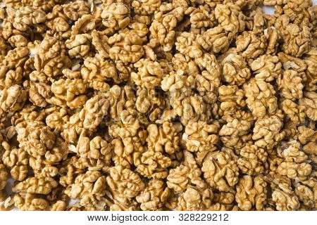 Big Kernels Walnuts Situated Arbitrarily. Closeup Of Big Shelled Walnuts. Walnut Background, Scatter