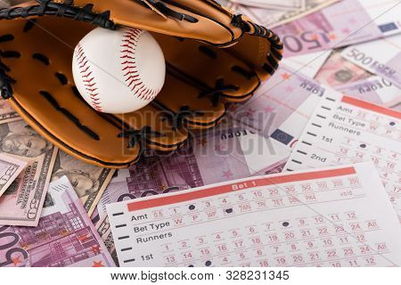 Baseball Glove And Ball Near Betting Lists On Euro And Dollar Banknotes, Sports Betting Concept
