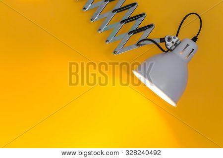 Stock Horizontal Photo Of Metal-coloured Flexo Lamp With Yellow Background. Design