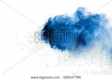 Blue Color Powder Explosion Cloud On White Background.closeup Of Blue Dust Particles Splash On Backg
