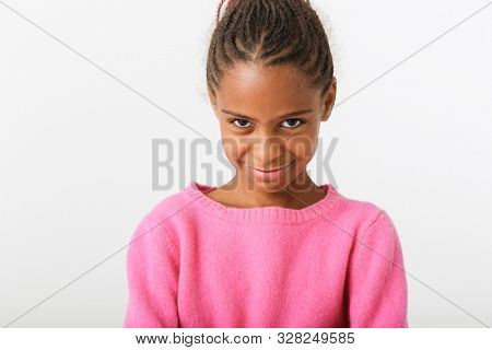 Image closeup of african american cocky girl looking at camera isolated over white background