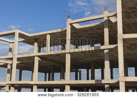 Concrete Structure Of Building Under Construction, Building Construction Site Work From Concrete, Co