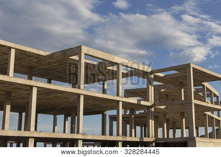 Building Construction Site Work From Concrete, Concrete Structure Of Building Under Construction, Co