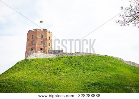 View Of The Castle On A Green Hill. Vilnius Is The Capital Of Lithuania.