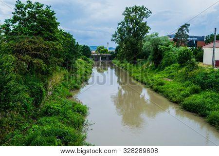 Bistrita River And Forest Codrisor In Bistrita City, Romania.
