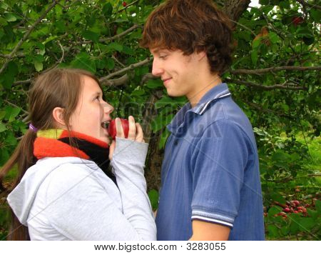 Young Lovers Eating Apple