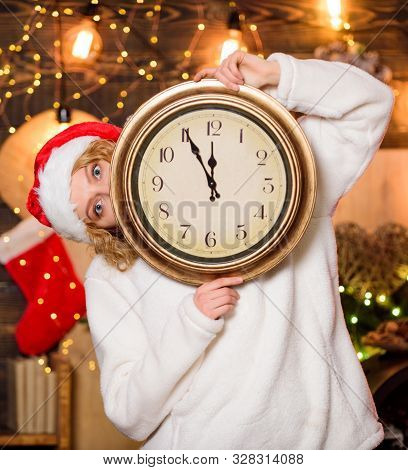 Woman Santa hat hold vintage clock. Time to celebrate. New year countdown. Unexpectedly soon. Midnight concept. Make wish. Merry christmas. Time for miracles. Few minutes left. Time for winter party poster