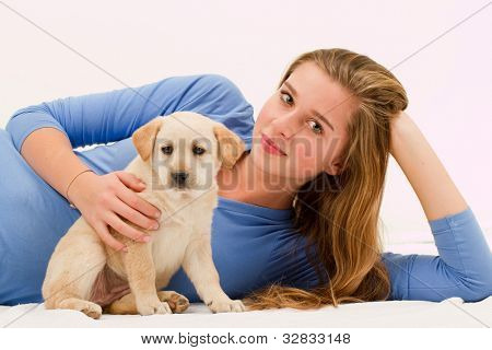 Lovely puppy and happy young girl - portrait of young female with her pet dog