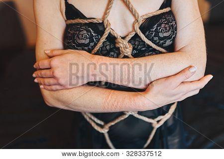 Shibari Style Photo Shoot. Body Parts. Silk Lingerie And Ropes.