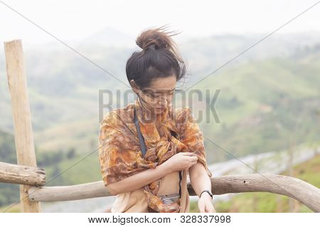 Portrait Of Asian Girl Are Standing On The Mountain For Looking The Sunrise At Petchabun Province ,