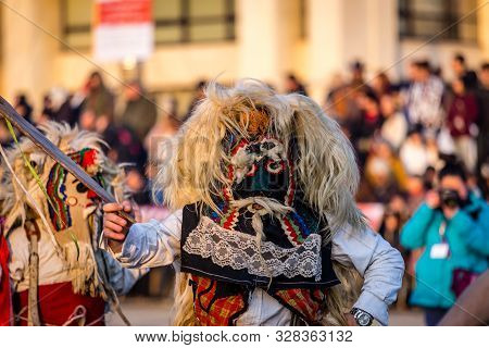 Mummers perform rituals to scare evil spirits at Surva festival at Pernik in Bulgaria. The people with the masks are called Kuker (kukeri). Mask from wool.