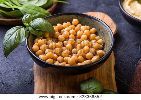 Chickpeas. Cooked Chickpeas And Homemade Hummus  On A Plate, Stone Background. Top View