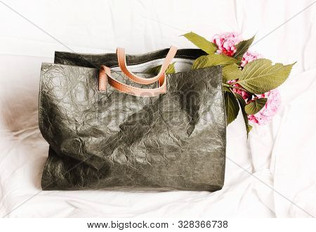 Bag green khaki casual with flowers inside on a white background poster