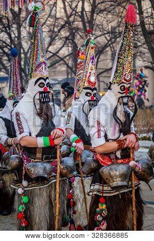 Mummers perform rituals to scare evil spirits at Surva festival at Pernik in Bulgaria. The people with the masks are called Kuker (kukeri). Motley mask.