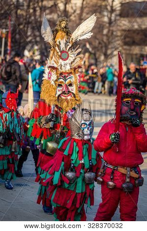 Mummers Perform Rituals To Scare Evil Spirits At Surva Festival At Pernik In Bulgaria. The People Wi