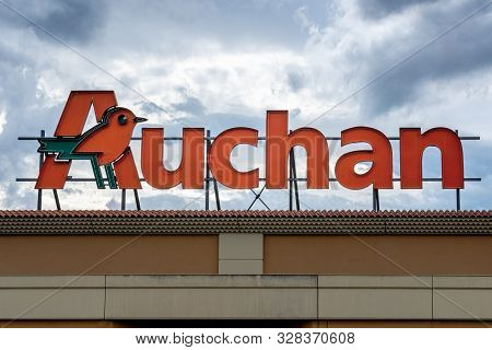 Guilherand-granges, France - October 17, 2019. Logo Of French Retailer Auchan Is Seen In Guilherand-