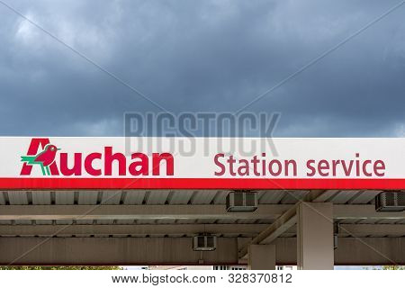 Guilherand-granges, France - October 17, 2019. Gas Station With Logo Of French Retailer Auchan Is Se