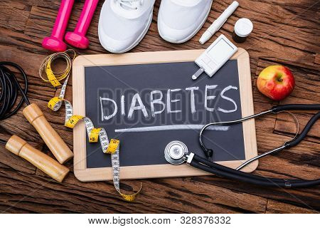 Blackboard With Diabetes Word Near Sports Equipment And Glucometer. Diabetes And Exercise Concept