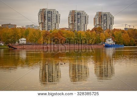 Khimki, Russia - October 10, 2019: The Barge Is Sailing Along The Moscow Canal Near The City Of Khim