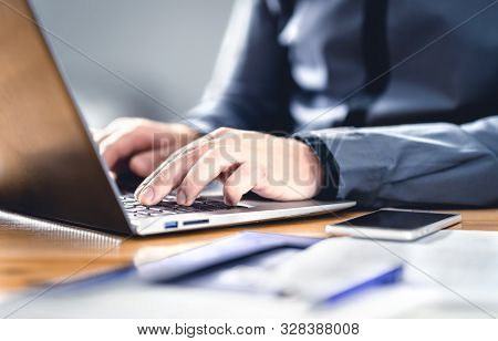 Man Writing With Laptop. Smart Hipster Guy With Finance, Market And Business Expertise. Freelance Wo
